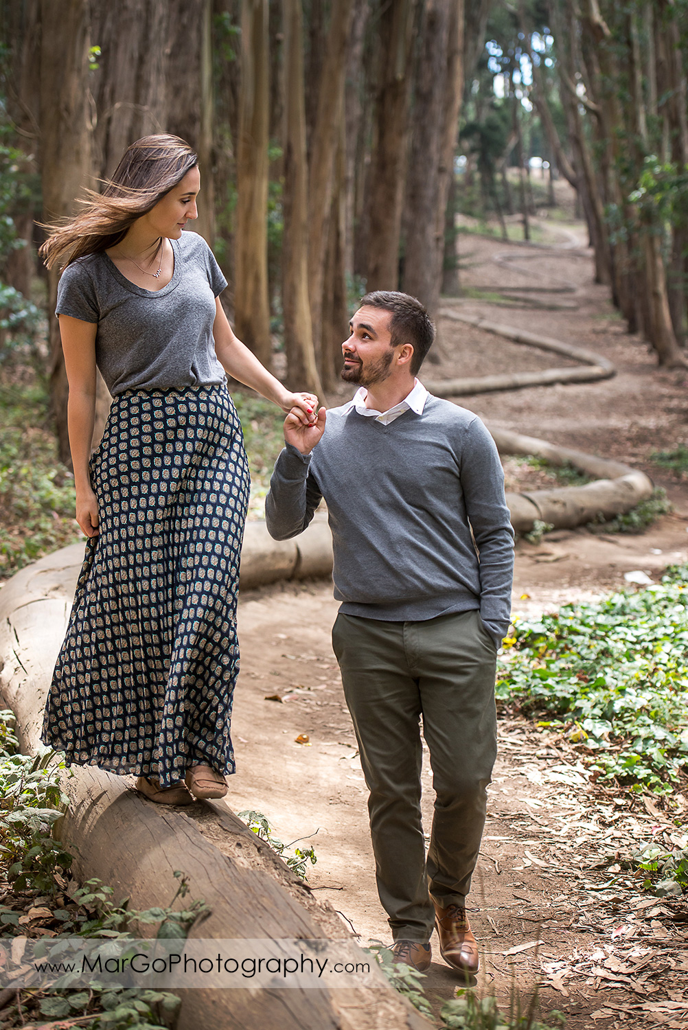 engagement session at Lover's Lane at the Presidio in San Francisco - couple holding hands and walking in the park