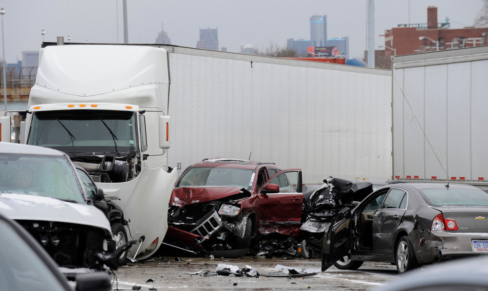 . A section of multi-vehicle accident on Interstate 75 is shown in Detroit, Thursday, Jan. 31, 2013. Snow squalls and slippery roads led to a series of accidents that left at least three people dead and 20 injured on a mile-long stretch of southbound I-75. More than two dozen vehicles, including tractor-trailers, were involved in the pileups. (AP Photo/The Detroit News, David Coates)