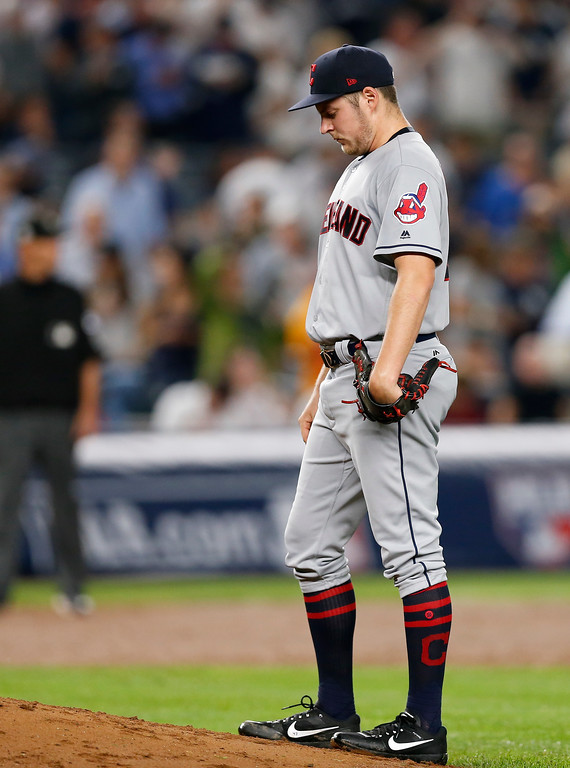 . Cleveland Indians pitcher Trevor Bauer reacts after giving up an RBI double to New York Yankees\' Todd Frazier during the second inning in Game 4 of baseball\'s American League Division Series, Monday, Oct. 9, 2017, in New York. (AP Photo/Kathy Willens)
