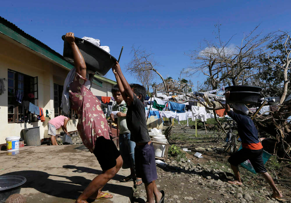 Description of . Typhoon evacuees prepare to do their laundry at an evacuation center at Maparat township, Compostela Valley in southern Philippines Saturday Dec. 8, 2012. Search and rescue operations following typhoon Bopha that killed nearly 600 people in the southern Philippines have been hampered in part because many residents of this ravaged farming community are too stunned to assist recovery efforts, an official said Saturday. (AP Photo/Bullit Marquez)