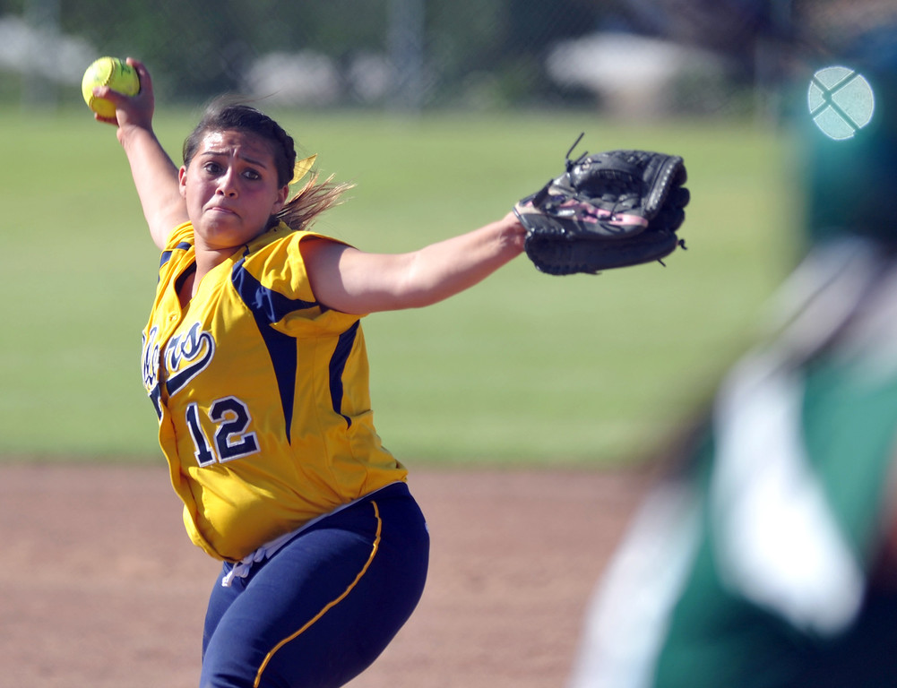 . Montebello\'s Evelyn Hernandez (#12) makes a pitch as they play Schurr in their Almont League girls softball game at Montebello High School on Thursday April 18, 2013. Montebello beat Schurr 10-8. (SGVN/Staff Photo by Keith Durflinger)