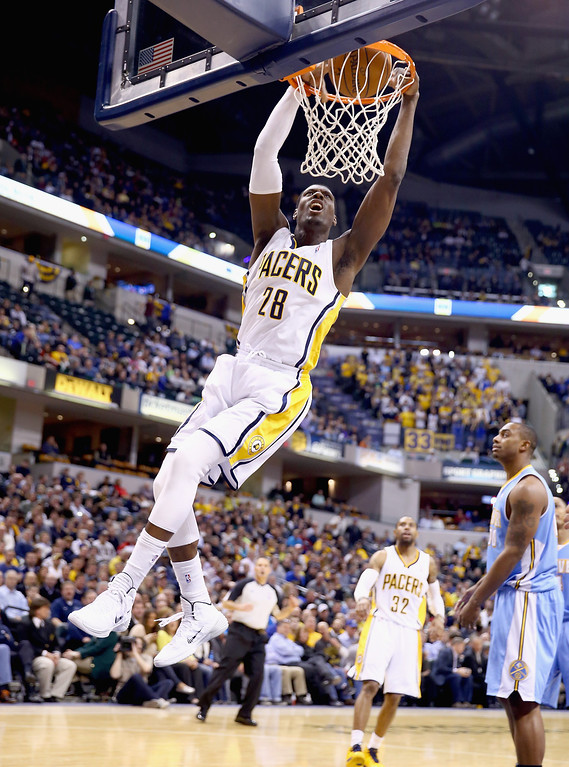 . Ian Mahinmi #28 of the Indiana Pacers shoots the ball during the game against the Denver Nuggets at Bankers Life Fieldhouse on February 10, 2014 in Indianapolis, Indiana.   (Photo by Andy Lyons/Getty Images)