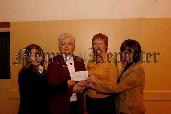Breffni Bridge Club Annual Charity Night, Rita Mc Quaid (president breffni bridge club) presents a Cheque for £200 for Newry Hospice to Marie Graham (hospice) second from left,also included are Gerry Moore (left) and Anne Mc Conville (right), 07W11N79