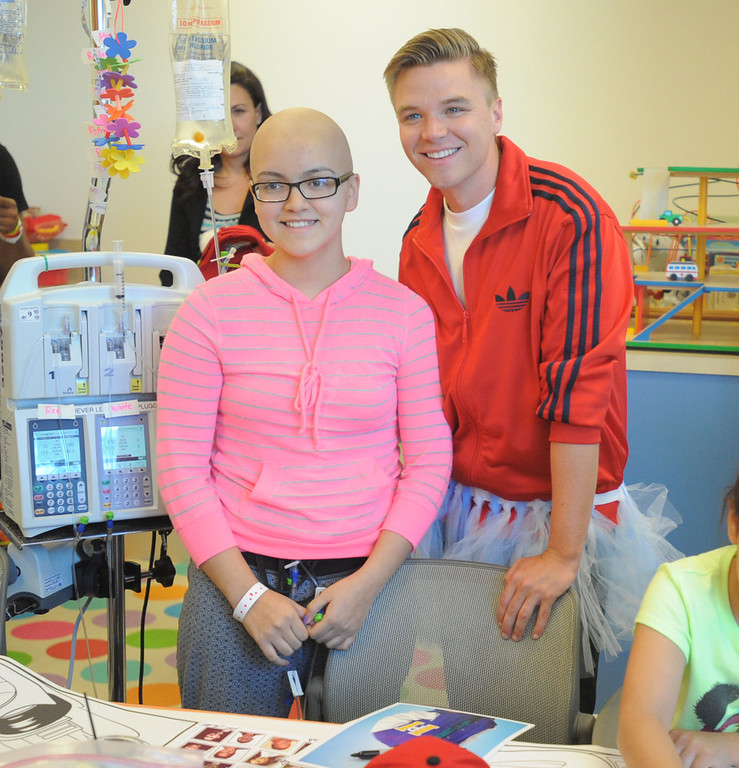 ". 04-18-2013-(LANG Staff Photo by Sean Hiller)-Toyota Grand Prix Celebrities visited Miller�s Children�s Hospital to visit the children they are raising money for through ""Racing for Kids.\"""