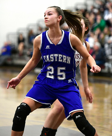 1/17/2019 Mike Orazzi | Staff Bristol Eastern's Sage Scarritt (25) and Bristol Central's Gwen Torreso (20) during Thursday night's girls basketball game at BC.