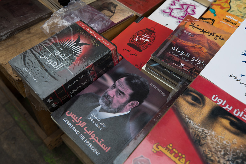"An Arabic translation of the book ""Debriefing The President"" by John Nixon for sale on Mutanabbi Street, a street filled with bookstores and outdoor book stalls and named after the 10th-century classical Iraqi poet Al-Mutanabbi."