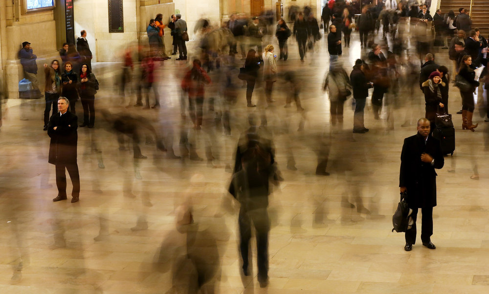 . People are blurred in a long exposure as they walk through Grand Central Terminal on the day before the famed Manhattan transit hub turns 100 years old on January 31, 2013 in New York City. The terminal opened in 1913 and is the world\'s largest terminal covering 49 acres with 33 miles of track. Each day 700,000 people pass through the terminal where Metro-Noth Railroad operates 700 trains per day.  (Photo by Mario Tama/Getty Images)