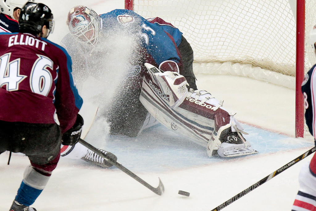. Colorado Avalanche goalie Jean-Sebastien Giguere (35) blocks a shot by Columbus Blue Jackets\' Nick Foligno, not seen, during the first period of an NHL hockey game on Monday, April 15, 2013 in Denver. (AP Photo/Barry Gutierrez)