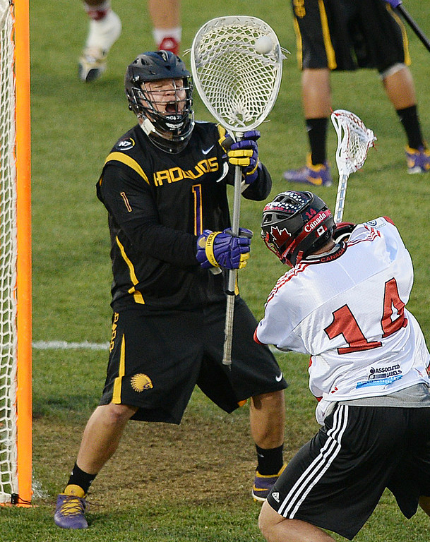 . COMMERCE CITY, CO - JULY 17: Iroquois goalie Warren Hill (1) made a save on a shot from Canada attack Wesley Berg (14) in the first half. The Iroquois Nationals took on Canada in a FIL World Championship semifinal game Thursday night, July 17, 2014.  Photo by Karl Gehring/The Denver Post