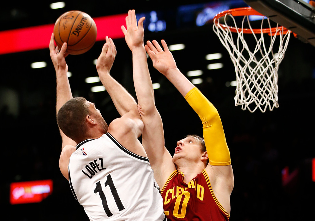 . Brooklyn Nets center Brook Lopez (11) shoots over Cleveland Cavaliers forward Kevin Love (0) in the second half of an NBA basketball game, Wednesday, Jan. 20, 2016, in New York. The Cavaliers defeated the Nets 91-78. (AP Photo/Kathy Willens)