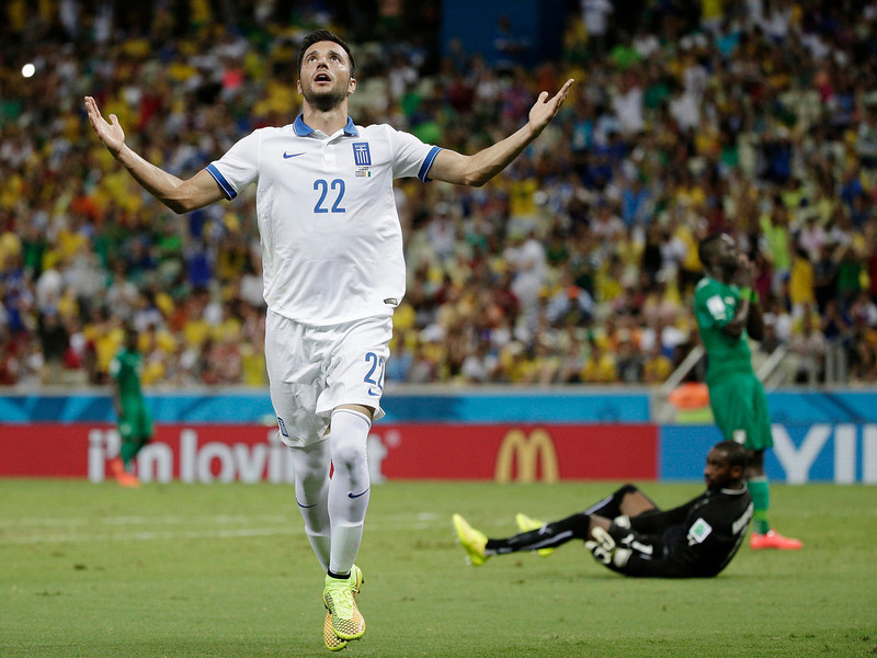 . Greece\'s Andreas Samaris celebrates after scoring his side\'s first goal against Ivory Coast\'s goalkeeper Boubacar Barry during the group C World Cup soccer match between Greece and Ivory Coast at the Arena Castelao in Fortaleza, Brazil, Tuesday, June 24, 2014.  (AP Photo/Christophe Ena)
