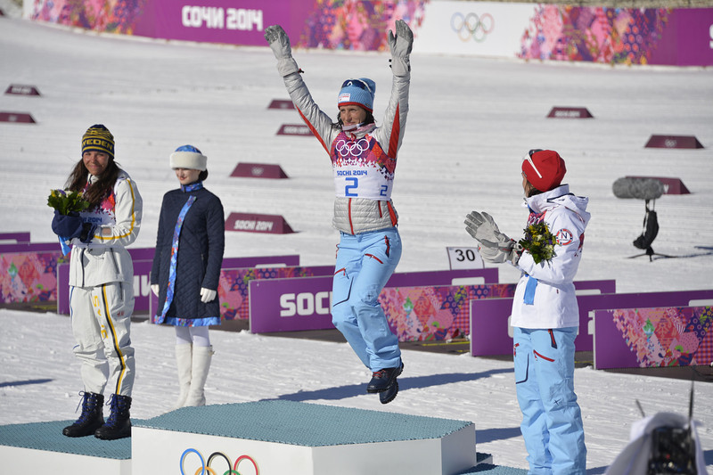 . (LtoR) Second placed Sweden\'s Charlotte Kalla, winner Norway\'s Marit Bjoergen and Norway\'s Heidi Weng celebrate during the flower ceremony after the Women\'s Cross-Country Skiing 7,5km + 7,5km Skiathlon at the Laura Cross-Country Ski and Biathlon Center during the Sochi Winter Olympics on February 8, 2014 in Rosa Khutor.  (ODD ANDERSEN/AFP/Getty Images)