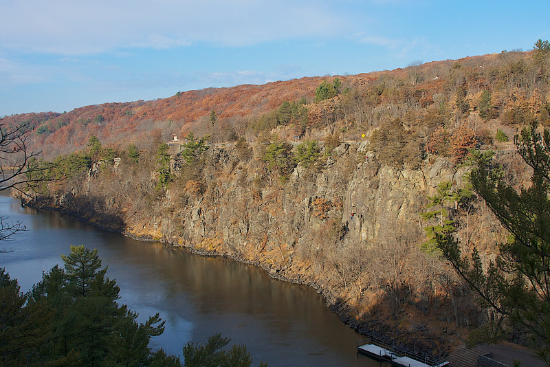 Rock climbing at Taylors Falls. The rock face on the right is what we were climbing. If you look close you will see a climber in red half way down and on top.