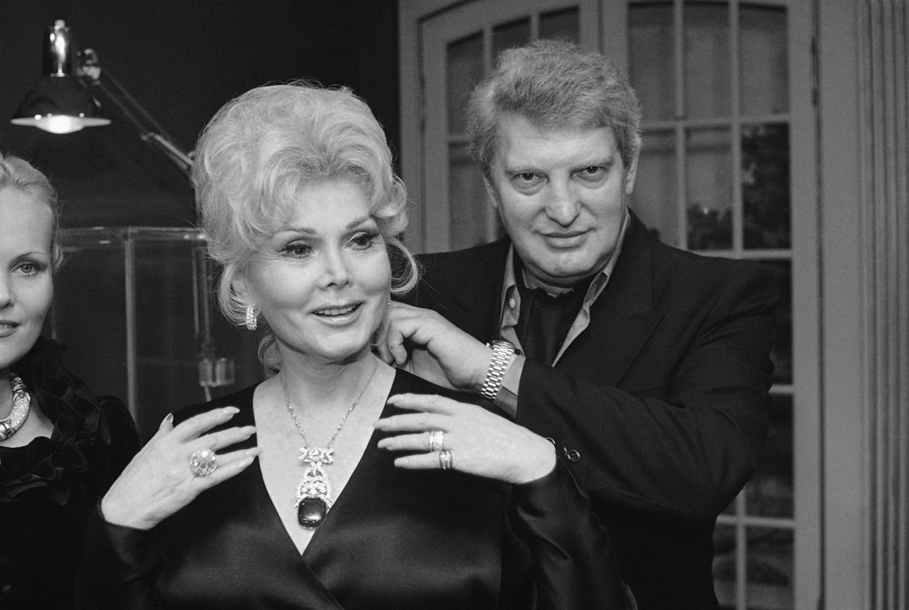 . Jeweler Edwin L. Haasman, right, places a one million dollar necklace with the 90 carat Maja emerald attached, around the neck of actress Zsa Zsa Gabor on Thursday. Nov. 3, 1979 in Los Angeles.   . (AP Photo/Wally Fong)
