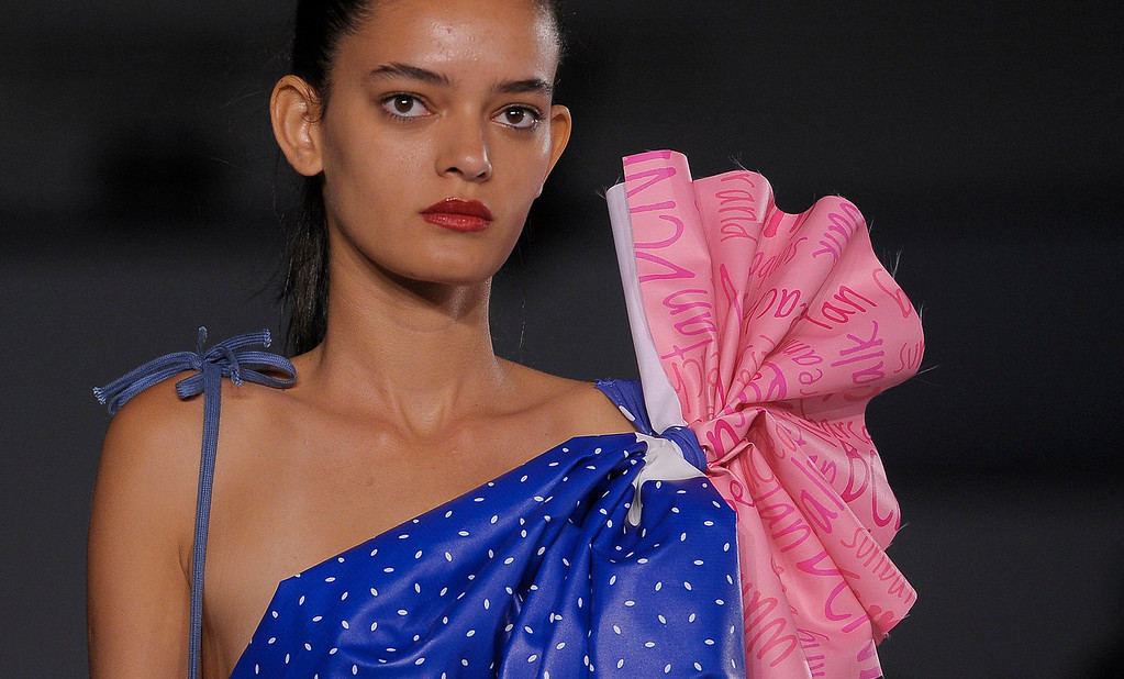 . A model wears a creation from BCN brand during a 080 Barcelona fashion show in Barcelona, Spain, Friday, July 12, 2013.  (AP Photo/Manu Fernandez)