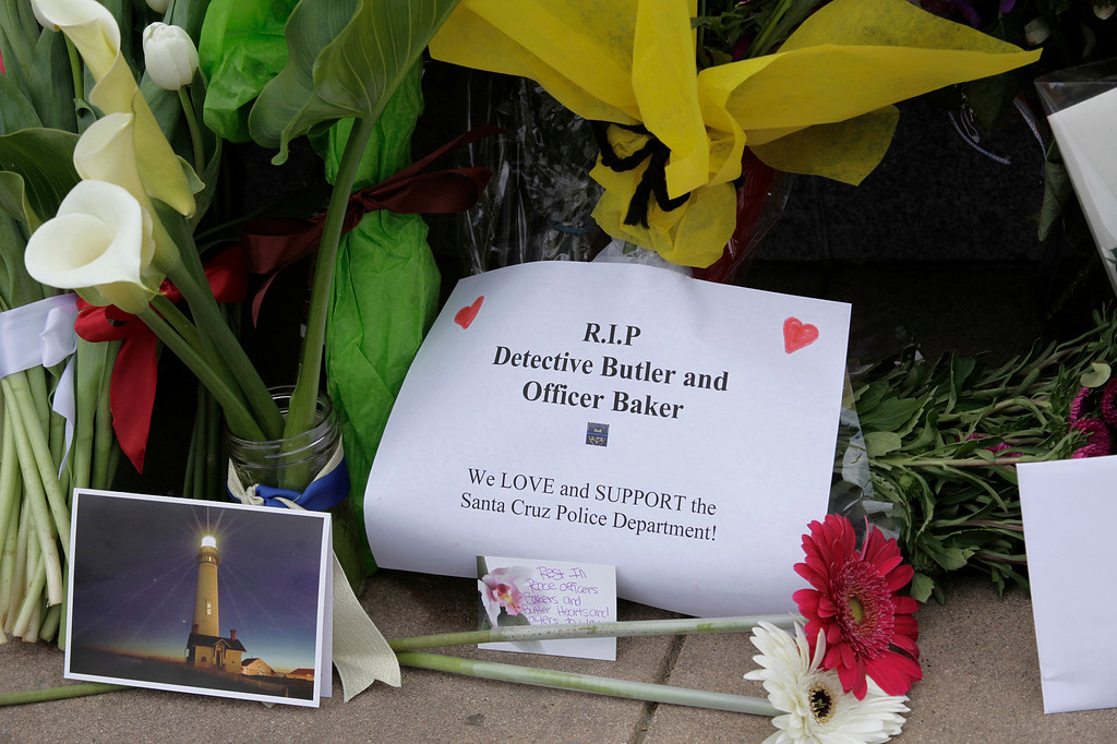 """. A makeshift memorial for slain Santa Cruz police officers, detective Sgt. Loran \""""Butch\"""" Baker and detective Elizabeth Butler has been created in front of the police department in Santa Cruz, Calif. on Wednesday, Feb. 27, 2013. The pair were gunned down yesterday while investigating a possible domestic violence or sexual assault when a suspect fired at them. The gunman, Jeremy Peter Goulet, was later gunned down when he exchanged gunfire with police during a manhunt. (Gary Reyes/ Staff)"""