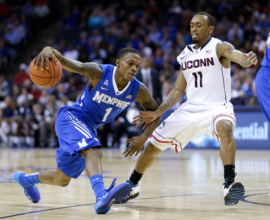 . Memphis guard Joe Jackson (1) drives against Connecticut guard Ryan Boatright (11) during the second half of an NCAA college basketball game in the quarterfinals of the American Athletic Conference men\'s tournament Thursday, March 13, 2014, in Memphis, Tenn. (AP Photo/Mark Humphrey)