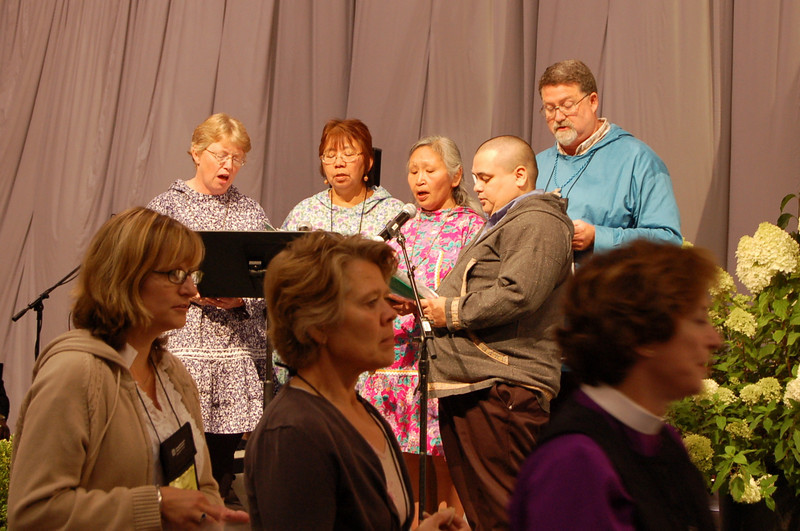 "During communion several singers from the Alaska Synod lead the assembly in ""He Leadeth Me""."