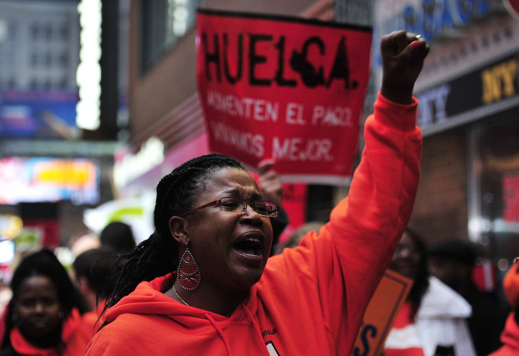 . Demonstrators outside a McDonald\'s restaurant near New York\'s Times Square as part of a nationwide protest of fast food workers December 5, 2013. AFP PHOTO/Stan HONDA/AFP/Getty Images
