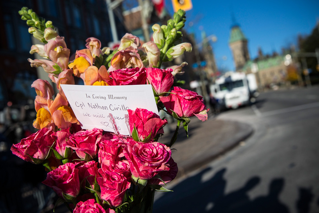 . Flowers are left in memorial for Cpl. Nathan Cirillo of the Canadian Army Reserves, who was killed yesterday while standing guard in front of the National War Memorial by a lone gunman, on October 23, 2014 in Ottawa, Canada.  (Photo by Andrew Burton/Getty Images)