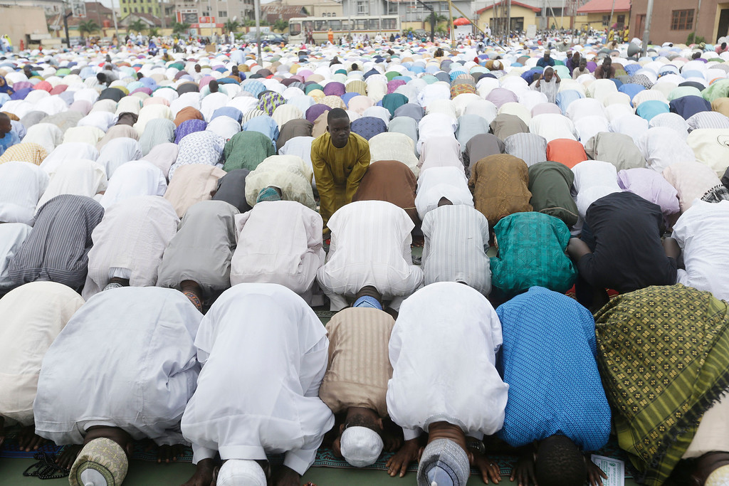 . Nigeria Muslims offer prayers to celebrate Edi al-Adha, or Feast of Sacrifice, that commemorates the Prophet Ibrahim\'s faith, at the prayer ground in Lagos, Nigeria, Monday, Sept. 12, 2016. Eid al-Adha marks the end of hajj. (AP Photo/Sunday Alamba)