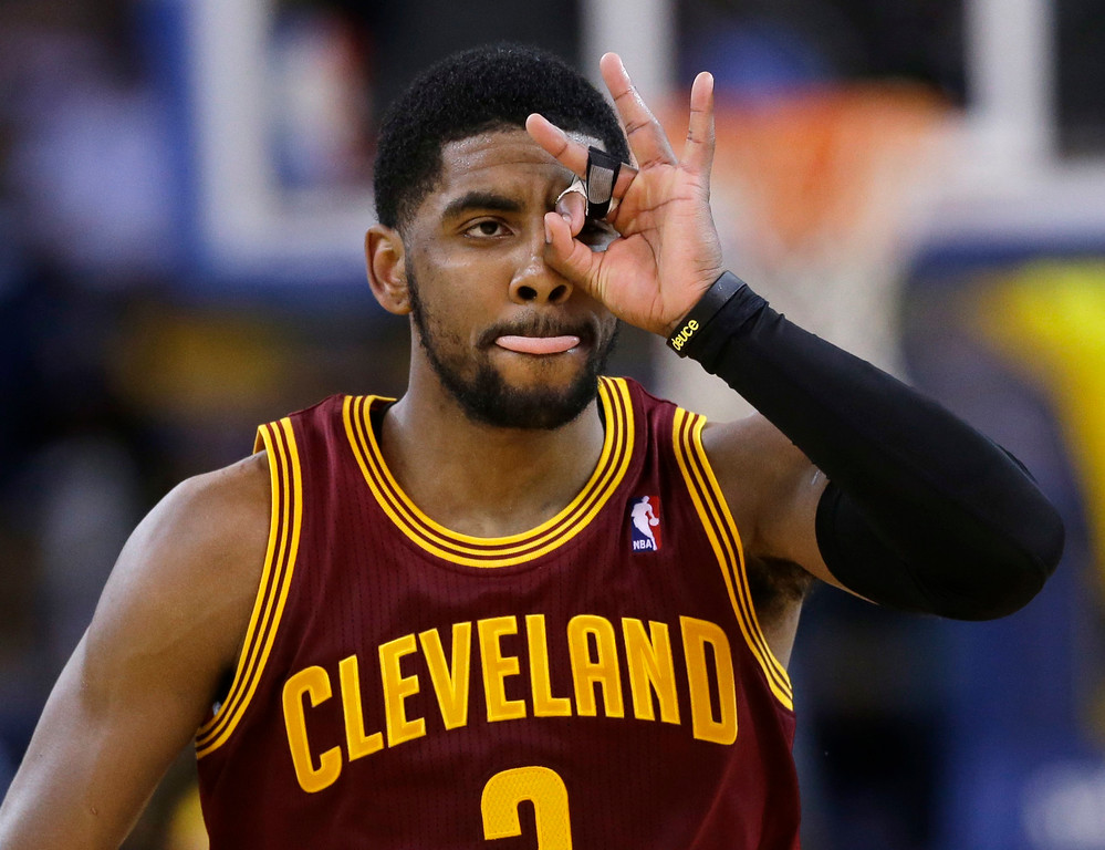 . Cleveland Cavaliers guard Kyrie Irving celebrates after making a three-point basket against the Golden State Warriors during the second half of an NBA basketball game on Friday, March 14, 2014, in Oakland, Calif. Cleveland won 103-94. (AP Photo/Marcio Jose Sanchez)