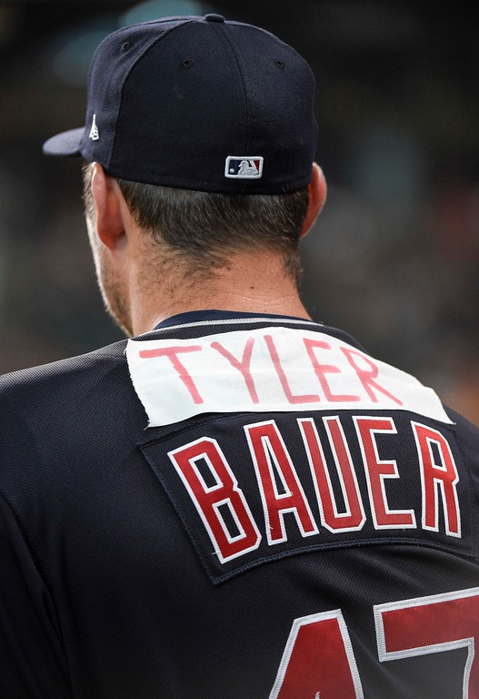". Cleveland Indians pitcher Trevor Bauer watches from the dugout with the name ""Tyler\"" on the back of his jersey during the first inning of a baseball game against the Houston Astros, Friday, May 18, 2018, in Houston. \""Tyler\"" was in reference to Houston Astros\' Alex Bregman response to Bauer\'s suggestions of cheating by Astros pitchers via Twitter on May 1. Bregman called Bauer \""Tyler.\"" (AP Photo/Eric Christian Smith)"
