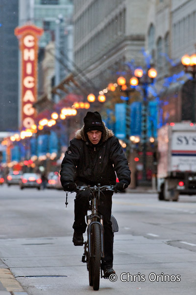 Chicago   USA Bicycling in front of the Chicago theater