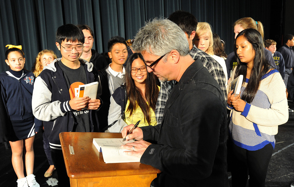 ". LONG BEACH - 03/19/2013  (Photo: Scott Varley, Los Angeles Newspaper Group)  Nearly 700 Long Beach students from Gompers, CAMS, Tincher, Hill and Wilson schools attend an event at Wilson High School auditorium where best-selling author Garth Stein talked about his book ""The Art of Racing in the Rain\"". The event was part of the Long Beach Reads One Book program. Following his talk to the students, Stein signs copies of his book for CAMS students."