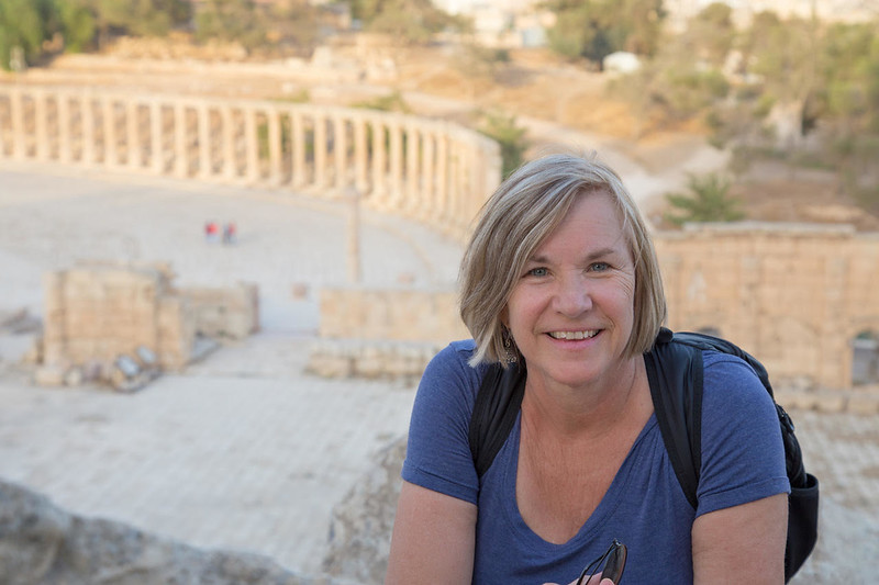 Debi Lander in front of Greek ruins.