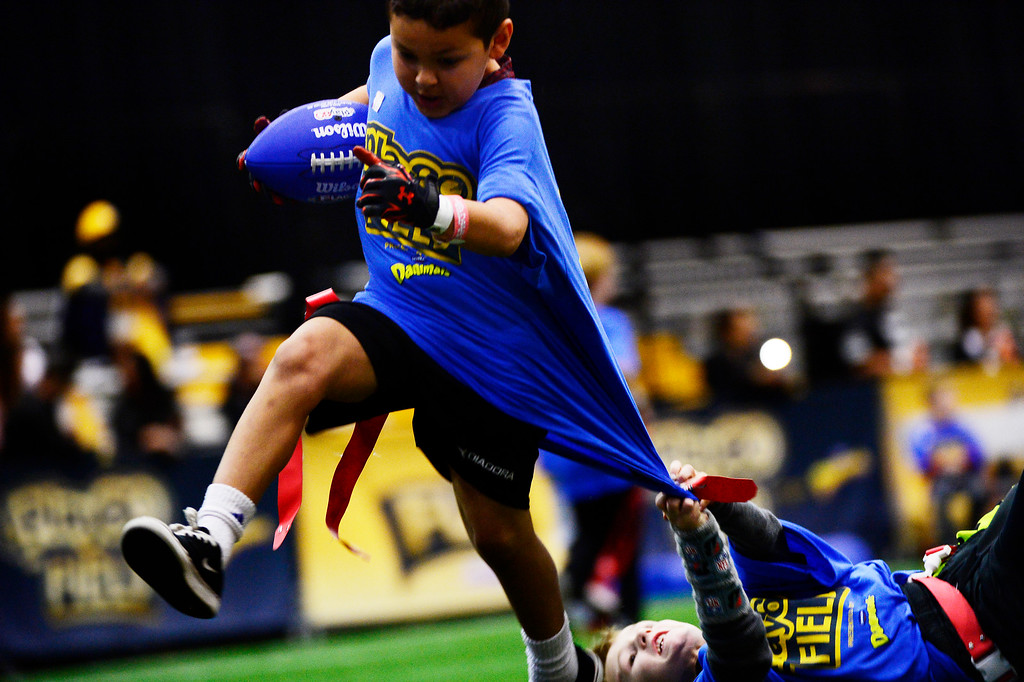 . SAN FRANCISCO, CA - FEBRUARY 05: Kids playing flag football on the Play 60 field at the NFL Experience in downtown San Francisco, CA. February 05, 2016 (Photo by Joe Amon/The Denver Post)