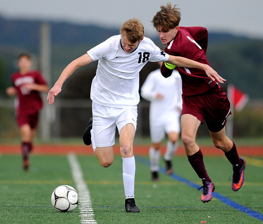10/17/2018 Mike Orazzi | Staff Newington's Erik Kozikowski (18) and Bristol Central's David Bowes (8) during boys soccer at BC Wednesday afternoon.