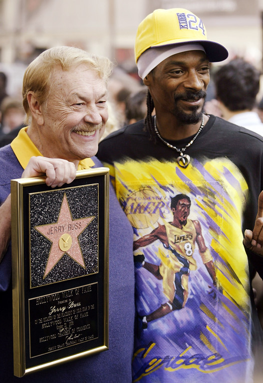 . Jerry Buss, left, owner of the Los Angeles Lakers team, poses with Snoop Dogg, after Buss was honored with a television star on the Hollywood Walk of Fame in the Hollywood section of Los Angeles, Monday, Oct. 30, 2006. (AP Photo/Damian Dovarganes)