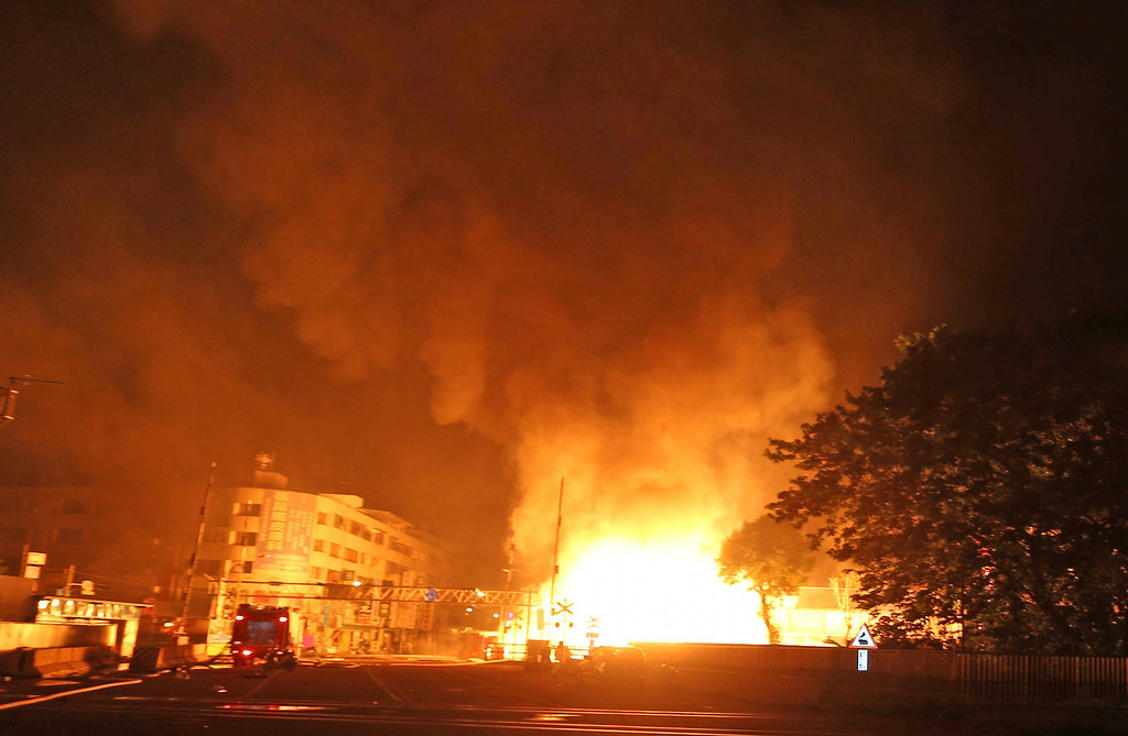 . Flames from an explosion from an underground gas leak in the streets of Kaohsiung, Taiwan, early Friday, Aug. 1, 2014.  A massive gas leakage early Friday caused five explosions that killed several people and injured over 200 in the southern Taiwan port city of Kaohsiung. (AP Photo)
