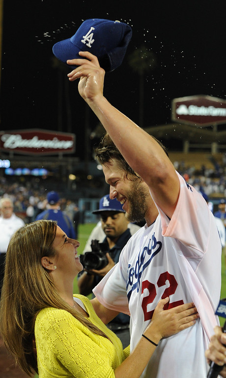 . Ellen celebrates with her husband Clayton Kershaw after he threw a no hitter. The Dodgers defeated the Colorado Rockies 8-0 at Dodger Stadium in Los Angeles, CA. 6/18/2014(Photo by John McCoy Daily News)