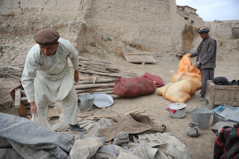 . Afghan rescuers go through items as they search for survivors trapped under the mud in Argo district of Badakhshan province on May 3, 2014 after a massive landslide May 2 buried a village. Rescuers searched in vain for survivors May 3 after a landslide buried an Afghan village, killing 350 people and leaving thousands of others feared dead amid warnings that more earth could sweep down the hillside. Local people made desperate efforts to find victims trapped under a massive river of mud that engulfed Aab Bareek village in Badakhshan province, where little sign remained of hundreds of destroyed homes. (FARSHAD USYAN/AFP/Getty Images)