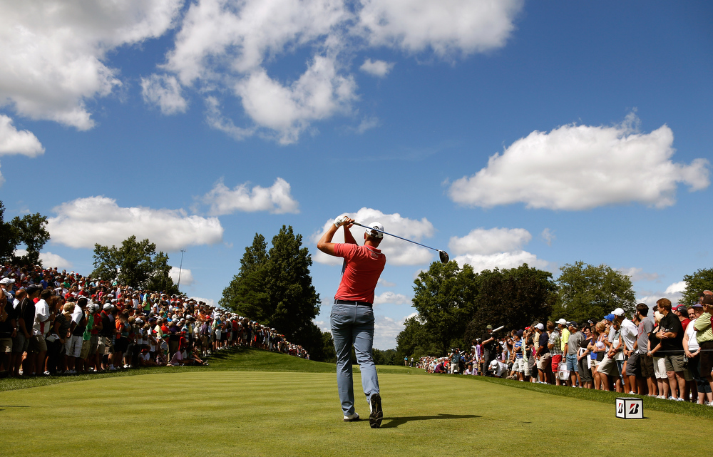 . Henrik Stenson of Sweden hits off the eighth tee during the Final Round of the World Golf Championships-Bridgestone Invitational at Firestone Country Club South Course on August 4, 2013 in Akron, Ohio.  (Photo by Gregory Shamus/Getty Images)