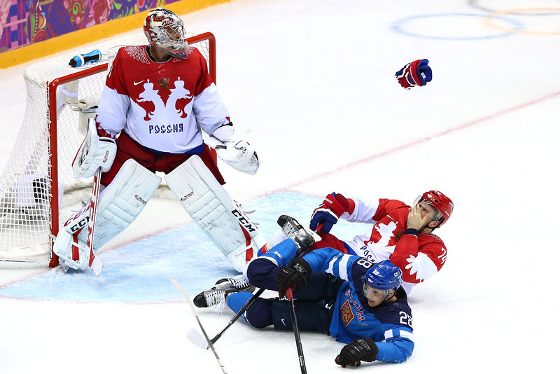 . Alexei Yemelin #74 of Russia gets hit in the face by the stick of Lauri Korpikoski #28 of Finland in front of the net of Semyon Varlamov #1 of Russia during the Men\'s Ice Hockey Quarterfinal Playoff on Day 12 of the 2014 Sochi Winter Olympics at Bolshoy Ice Dome on February 19, 2014 in Sochi, Russia.  (Photo by Clive Mason/Getty Images)
