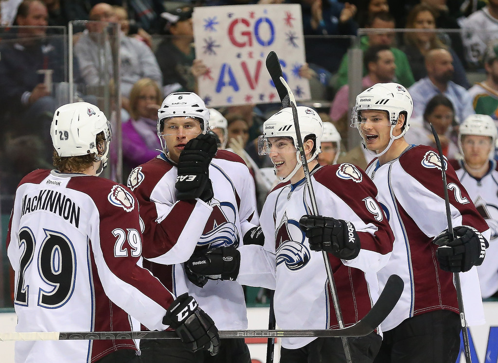 . From left, Nathan MacKinnon, Erik Johnson #6, Matt Duchene #9 and Nick Holden #2 of the Colorado Avalanche celebrate a goal against the Dallas Stars in the second period at American Airlines Center on December 17, 2013 in Dallas, Texas.  (Photo by Ronald Martinez/Getty Images)