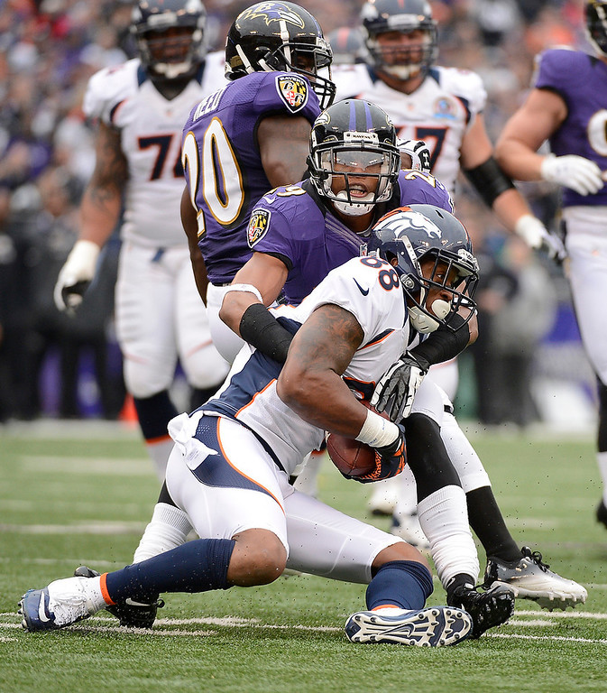. Denver Broncos wide receiver Demaryius Thomas (88) is brought down by Baltimore Ravens cornerback Cary Williams (29) after a short gain during the second quarter Sunday, December 16, 2012 at M&T Bank Stadium. John Leyba, The Denver Post