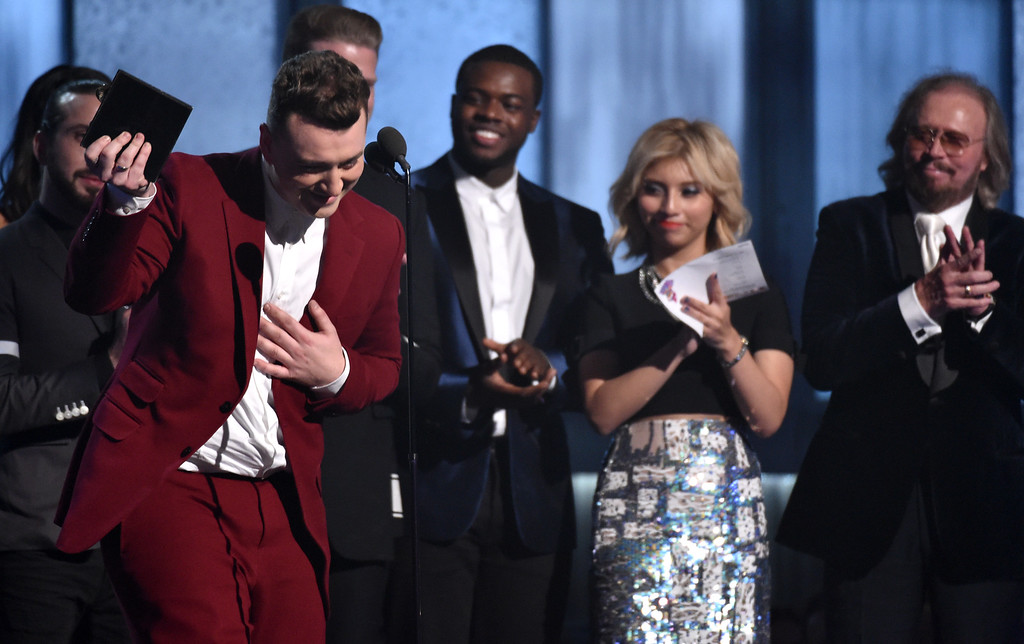 . Sam Smith accepts the award for best pop vocal album for �In the Lonely Hour� at the 57th annual Grammy Awards on Sunday, Feb. 8, 2015, in Los Angeles. (Photo by John Shearer/Invision/AP)