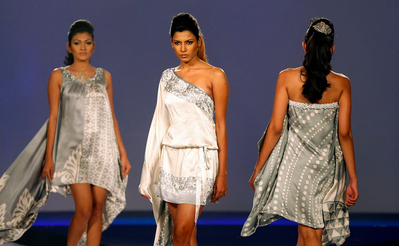 . In this Wednesday, April 3, 2013 photo, models present creations by Spa Ceylon during Colombo Fashion Week in Colombo, Sri Lanka. (AP Photo/Eranga Jayawardena)