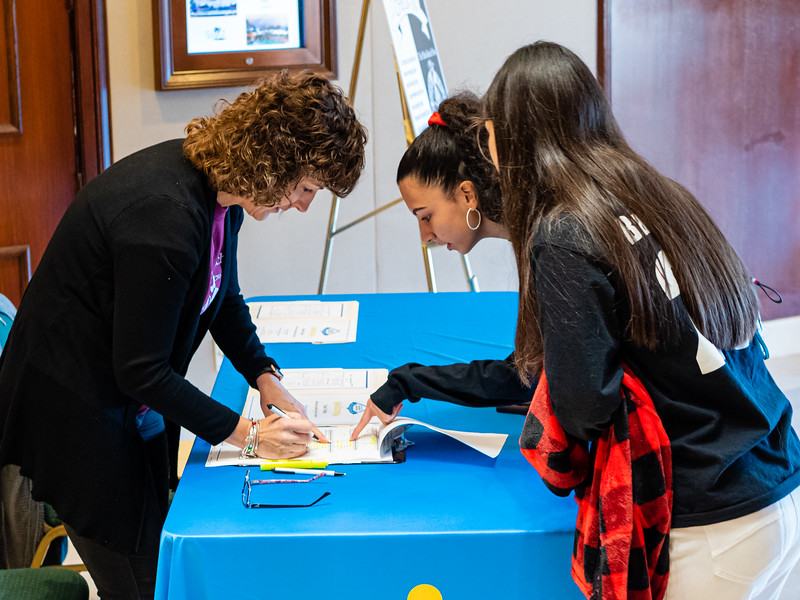 Palm Beach Post staffer Tami Tolley checks students into the High School Journalism Workshop, hosted by the Palm Beach Post at the Airport Hilton in West Palm Beach on Thursday, December 5, 2019. [JOSEPH FORZANO/palmbeachpost.com]