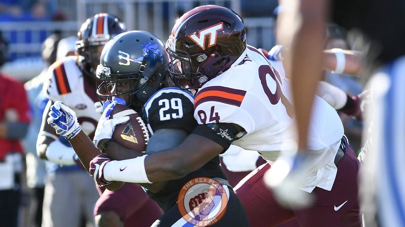 Virginia Tech defensive end Trevon Hill (94) hits Duke running back Shaun Wilson. (Michael Shroyer/TheKeyPlay.com)