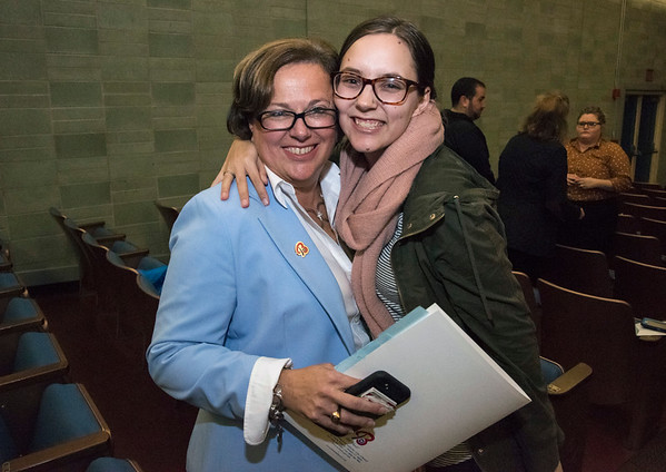 10/22/19 Wesley Bunnell | StaffrrCandidates for mayor and City Council met on Tuesday night at St. Paul Catholic High School's Auditorium for a question and answer forum for council candidates followed by a mayoral debate. Mayor Ellen Zoppo-Sassu receives a hug from daughter Michaela Sassu just before the debate.
