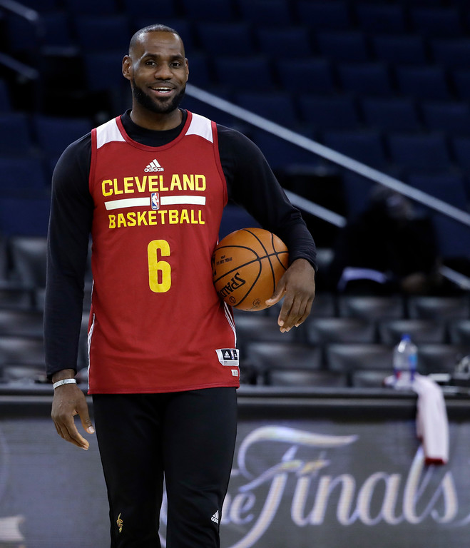. Cleveland Cavaliers\' LeBron James holds a ball during an NBA basketball practice, Wednesday, May 31, 2017, in Oakland, Calif. The Cavaliers face the Golden State Warriors in Game 1 of the NBA Finals on Thursday in Oakland. (AP Photo/Marcio Jose Sanchez)