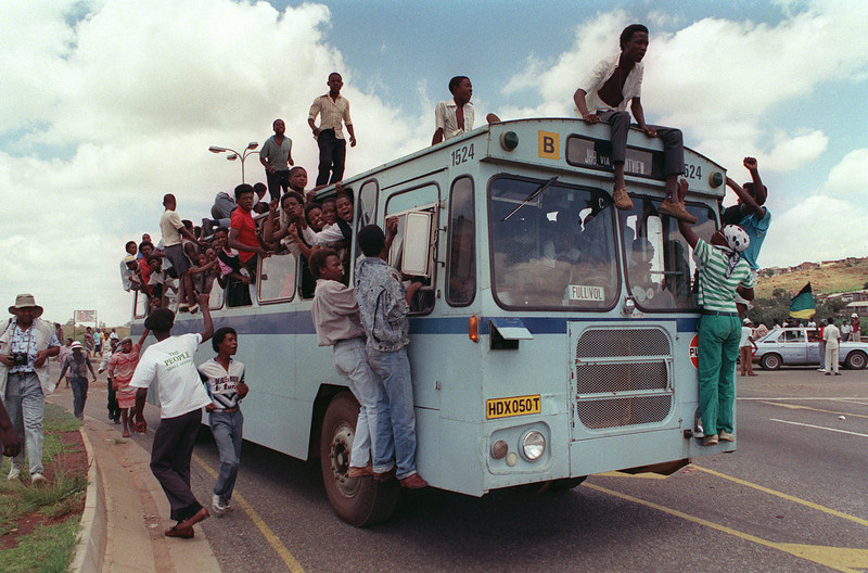 . Jubilant inhabitants of Soweto find room where they can in and on a bus to reach Orlando stadium in Soweto, 12 February 1990, to attend a mass African National Congress (ANC) rally to be addressed by freed anti-apartheid leader and African National Congress (ANC) member Nelson Mandela. It\'s the first rally Nelson Mandela is holding since his release from jail, 11 February 1990. The rally was originaly called for to celebrate the unbanning of the ANC but turned out to be a celebration for the release from jail of Nelson Mandela.        (Photo credit should read TREVOR SAMSON/AFP/GettyImages)