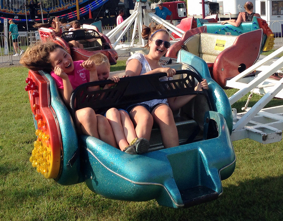 . Fair goers reacts as they ride  on the rides on the midway at the Boonville Oneida County Fair on Tuesday, July 22, 2014 in Boonville. the fair runs through Sunday, July 27, 2014. JOHN HAEGER-ONEIDA DAILY DISPATCH @ONEIDAPHOTO ON TWITTER