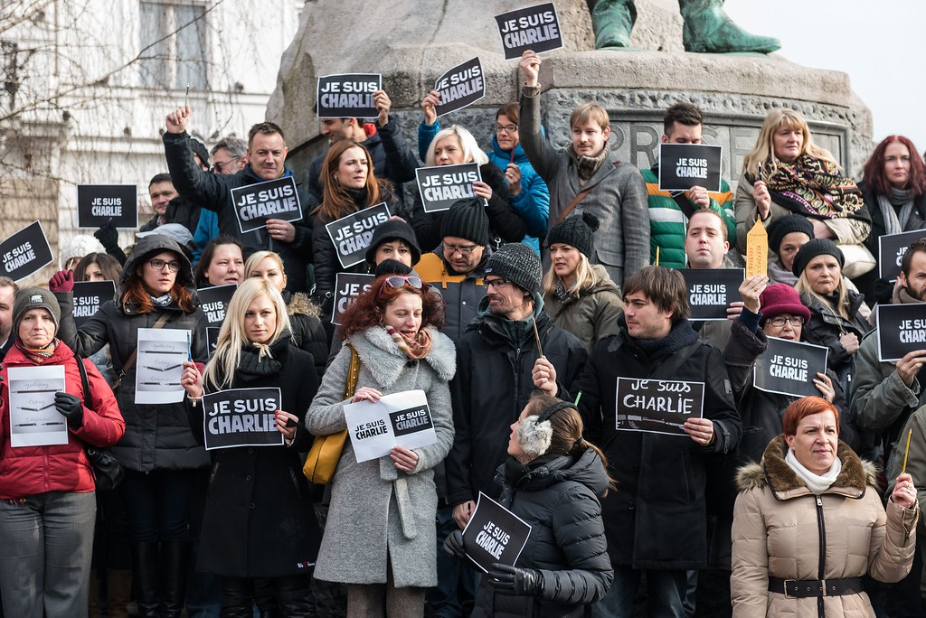 ". Slovenian journalists hold pens and placards reading in French ""I am Charlie\"" during a gathering in tribute of victims of the attack on French satirical weekly Charlie Hebdo, on January 8, 2015 in Ljubljana, a day after two gunmen killed 12 people in an Islamist attack at Charlie Hebdo\'s editorial office in Paris. The massacre, the country\'s bloodiest attack in half a century, triggered poignant and spontaneous demonstrations of solidarity around the world. Charlie Hebdo is famed for its irreverent views of religion and its decision to publish controversial cartoons of the prophet Mohammed. AFP PHOTO / JURE  Makovec/AFP/Getty Images"
