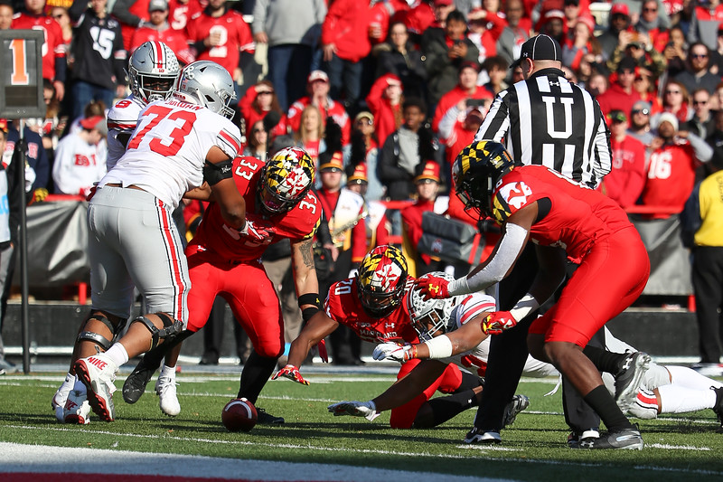 Ohio State RB #2 J.K. Dobbins fumbles the ball just short of the goal line, and Maryland DB #20 Antwaine Richardson recovers the fumble.